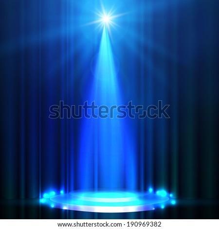 spotlight on blue stage curtain