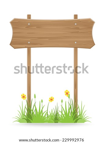 wooden signpost on grass with