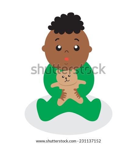 a baby boy holding a teddy bear