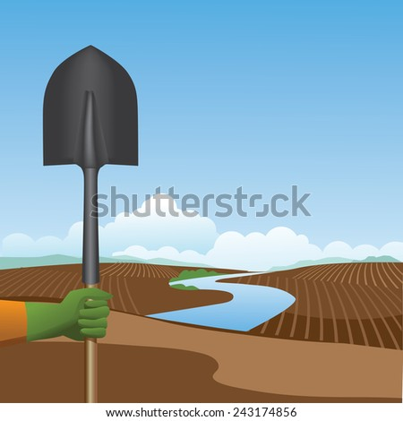 holding a shovel before a