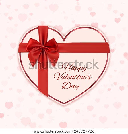 paper heart with red ribbon and