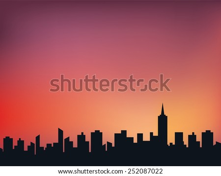 silhouette of town at midnight