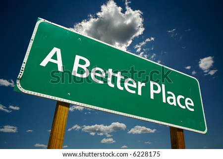 """""""A Better Place"""" Road Sign with dramatic blue sky and clouds. - stock photo"""