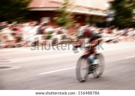 a bicyclist in a race with motion blur  - stock photo