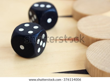 A board game backgammon: dice, checkers and playing field macro. - stock photo