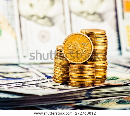 a coin in the one dollar,  located on the American dollars - stock photo