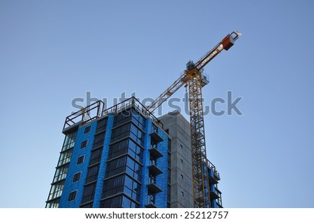 A crane is working. - stock photo