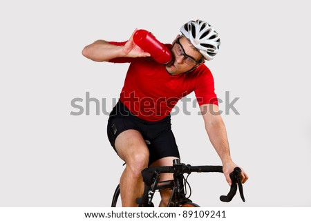 a cyclist drinking while driving - stock photo