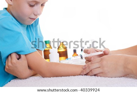 A doctor giving a child an injection