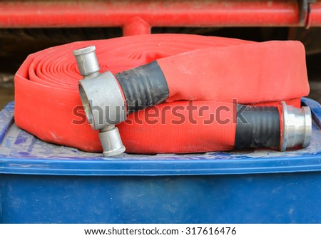 A firefighter hose on the blue box in front  fire station used by firefighters. - stock photo