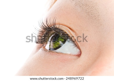 a green colored contact lens asian girl eye - stock photo