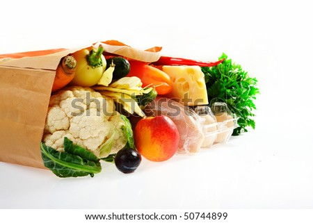 A grocery bag full of healthy food - stock photo
