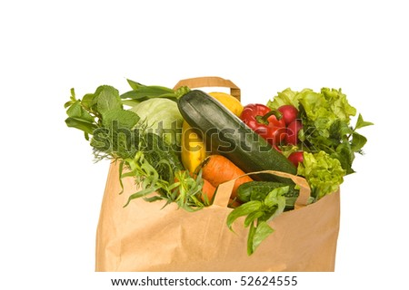 A grocery bag full of healthy vegetables - stock photo