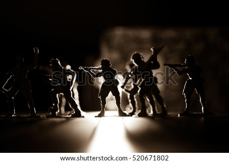 A group of green plastic toy soldiers, Concept idea of World War 3