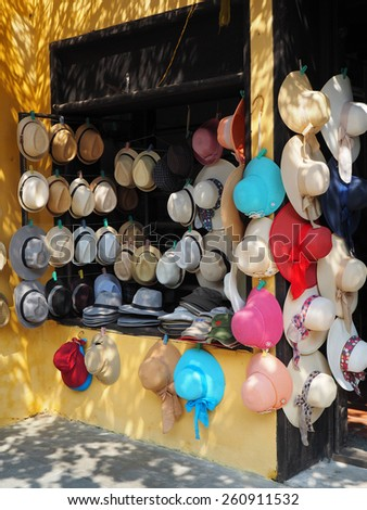 a hat shop for selling on sidewalk in Hoi an Vietnam         - stock photo