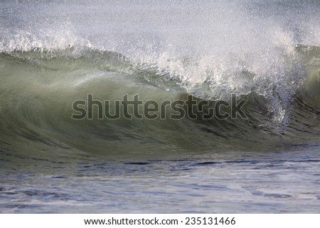 A Huge Pacific Ocean Wave Breaks on the Beach - stock photo