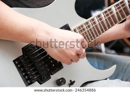 a man is playing on white guitar - stock photo