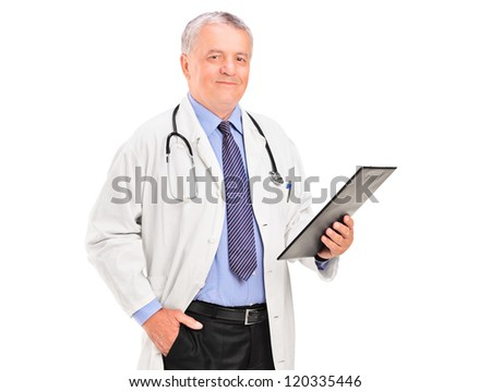 A mature doctor holding a clipboard and posing isolated on white background - stock photo