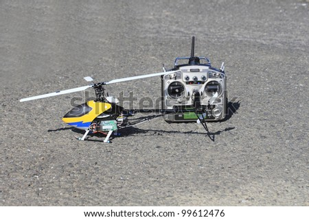 a model helicopter and remote control - stock photo