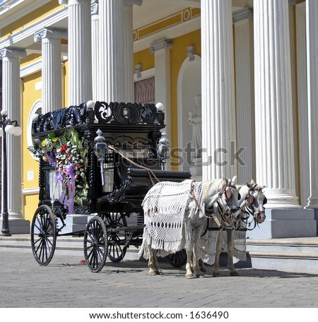 a old black hearse wagon - stock photo