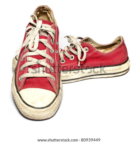 A pair of old sneakers, isolated on white background - stock photo