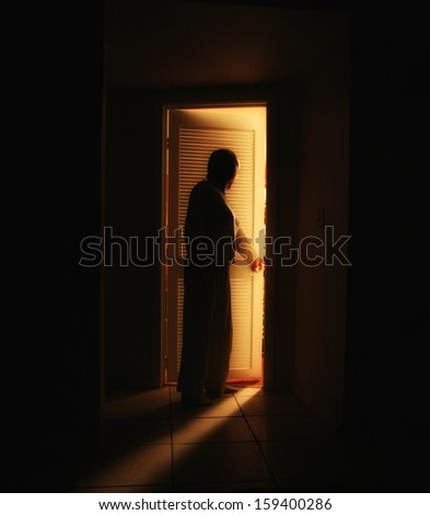 a person outside a bedroom door  - stock photo