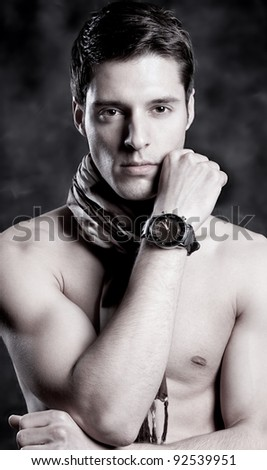 A portrait about a trendy attractive guy  who has glamorous look - stock photo