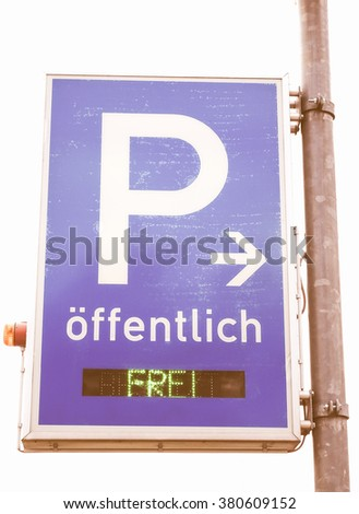 A road sign for a parking area - Oeffentlich means public vintage - stock photo