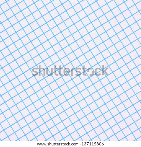 A sheet of blue and white graph paper photographed in a diagonal composition to provide an background