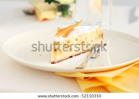 A slice of Baked ricotta cake with candied peel
