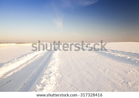 a small road in the winter season. winter. track. - stock photo
