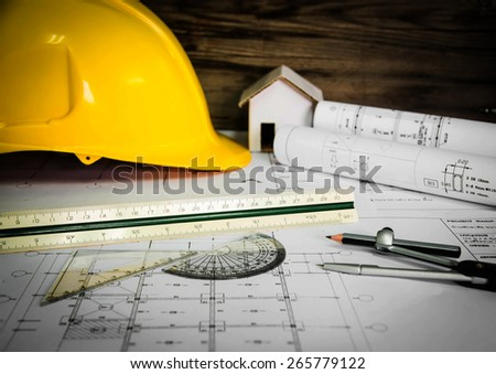 A stationery over blurred architectural blueprint of office building