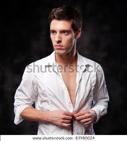 A trendy European man dressed in contemporary white shirt. - stock photo