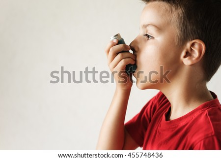 a very sick boy who keeps respirator lungs, blows air out of the inhaler