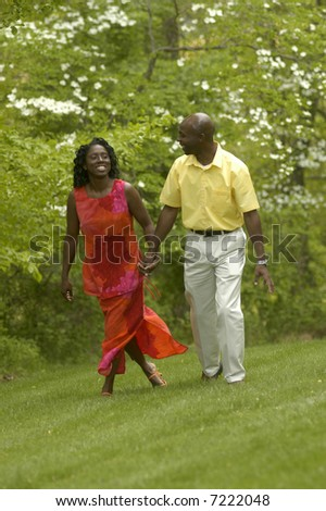 a walking couple enjoying a Spring day