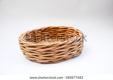 A wooden basket, on empty decorative,  isolated on white background - stock photo
