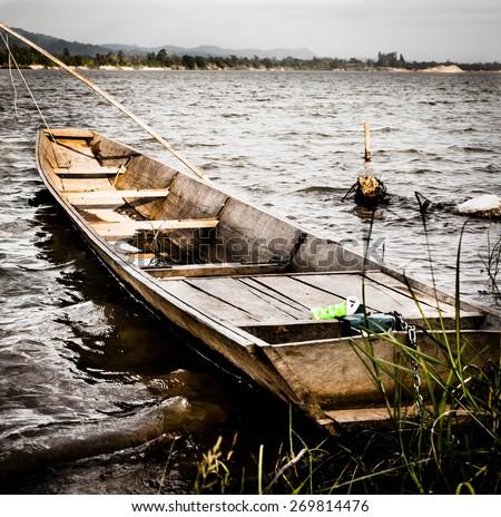 Abandoned boat on the lake - stock photo