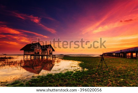 Abandoned house with evening light that photographers are drawn to photography in Thailand with bulr background. - stock photo