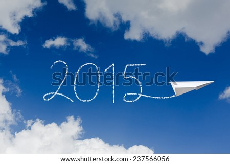 2015 above the clouds with paper plane  - stock photo
