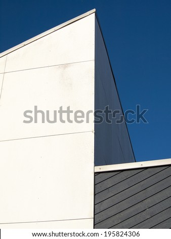 abstract architecture in clear straight lines blue sky background