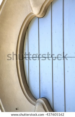 abstract church door   in italy   lombardy   column  the milano old      closed brick