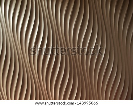 Abstract wave curve pattern on wall background - stock photo
