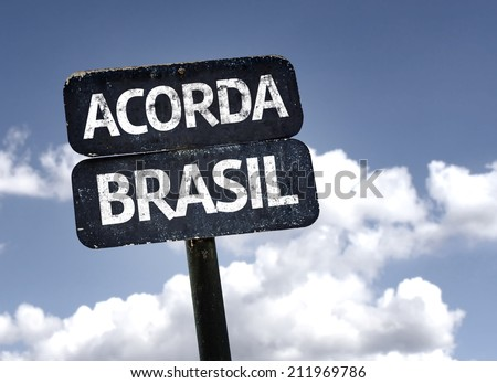 """""""Acorda Brasil"""" (In portuguese: Brazil Wake Up) sign with clouds and sky background  - stock photo"""