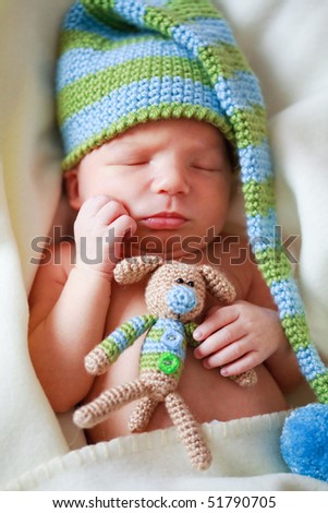 adorable newborn baby with teddy - stock photo