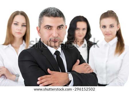 Adult businessman standing in front of his colleagues with his arms crossed on chest. Group of business people team. Isolated on white background. - stock photo