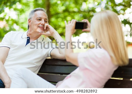 Adult couple taking a picture at the park