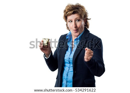 Adult woman with suit makes a gesture of celebration and success while holding a paper cup for coffee isolated on white background