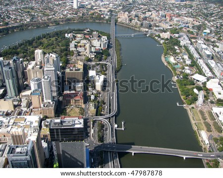 Aerial view of Brisbane, capital of Queensland, Australia.  The City is split by the Brisbane River with CBD to the left and South Bank Parklands to the right. - stock photo