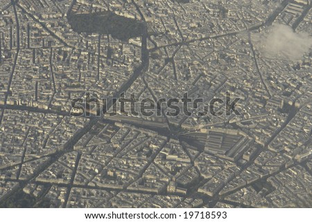 "Aerial view of paris over ""l'Arc de Triomphe""."
