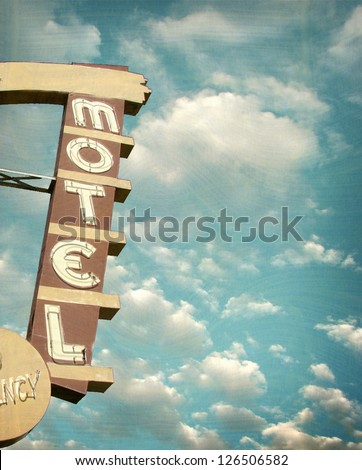 age and worn vintage photo of neon motel sign - stock photo